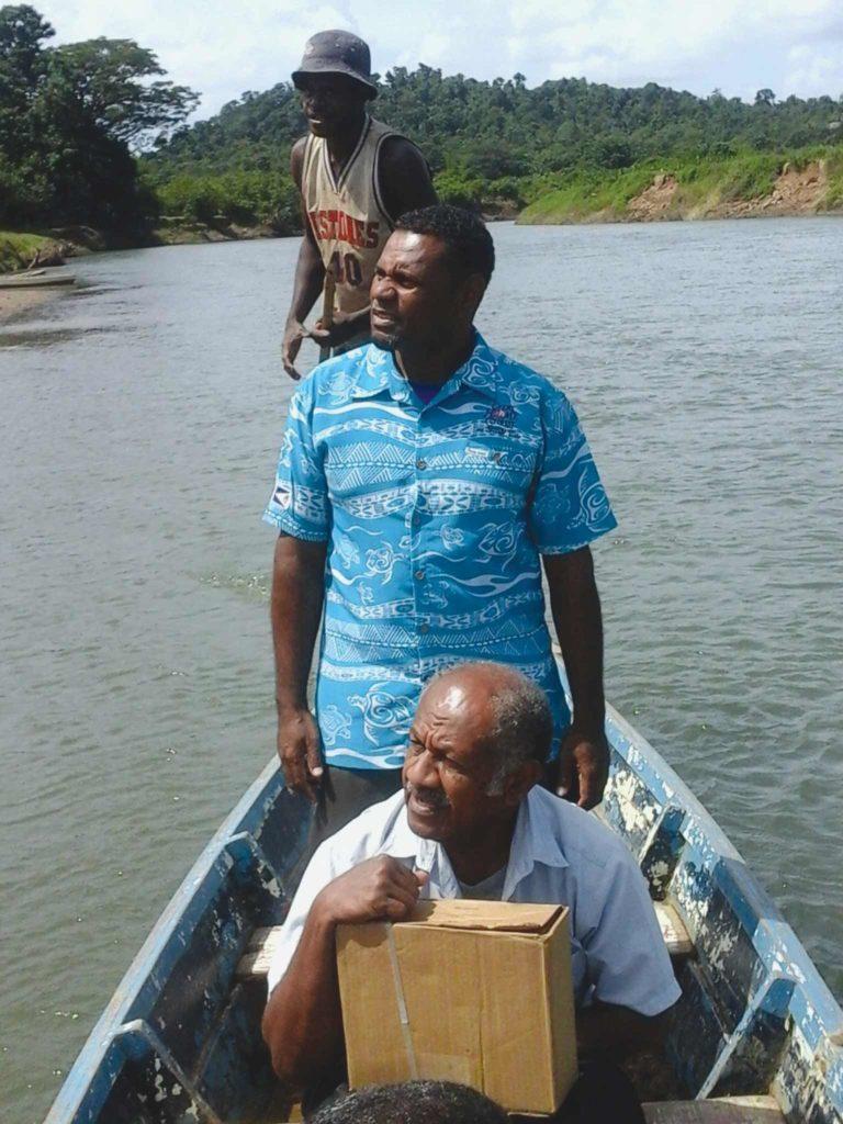 Two men canoe down a river
