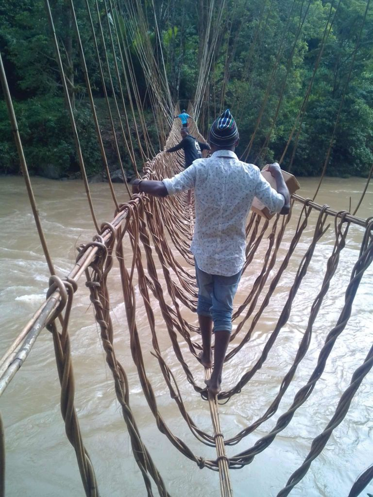 A man crosses a rope river